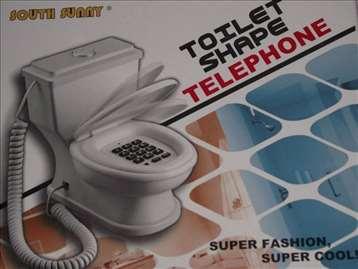 Fixni telefon u obliku wc šolje