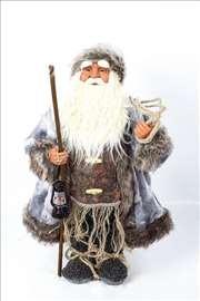 Deda mraz sa štapom i fenjerom