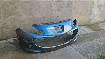 Prodajem original prednji branik za Peugeot 207
