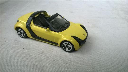 Burago Smart cabrio žuti 1:43, China, očuvan