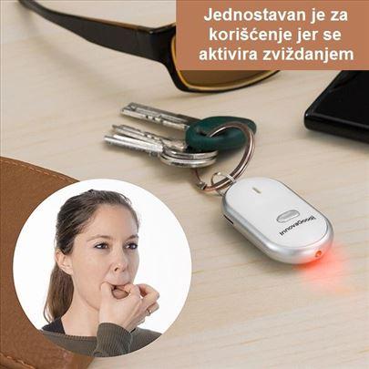 Privezak za ključeve sa zvučnim signalom i LED lam