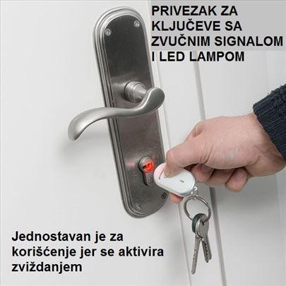 Privezak za ključeve sa zvučnim sig. i LED lampom