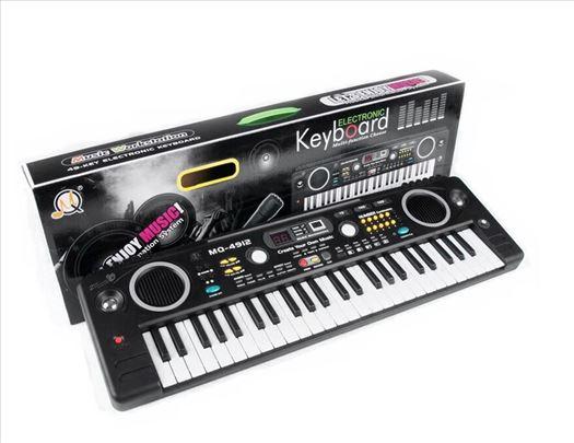 Muzički sintisajzer + mikrofon za decu