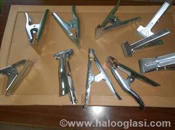 Držači-štipaljke za krojenje