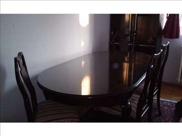 Stilski sto elipsastog oblika sa 6 stolica